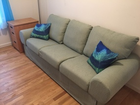 Here's the finished product, with some coordinating throw pillows I bought on Etsy.