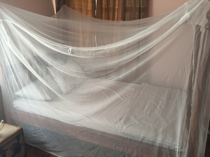 Sleeping under a mosquito net every night was part of my malaria prevention in Uganda.